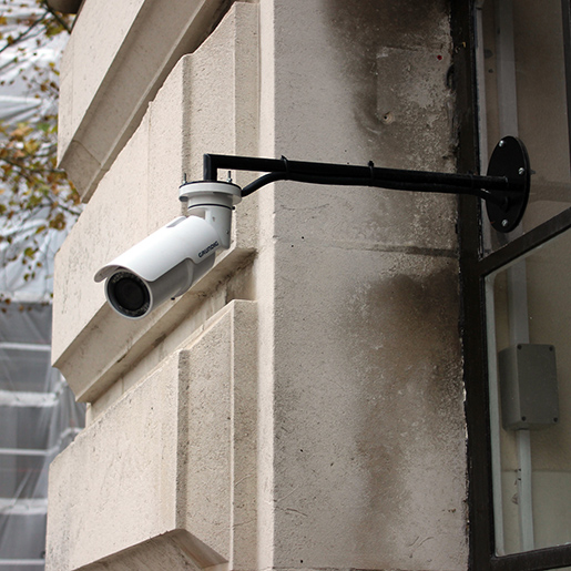 A closer view of how these bullet IP cameras are mounted on the window glass.