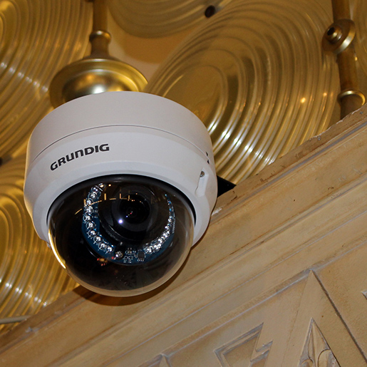 One of the internal dome IP cameras, discretely installed through the use of a bracket, mounting it over the edge of a ledge.