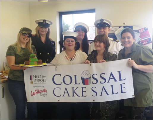 Entering into the spirit of the week by dressing up in military attire on Armed Forces day (the Friday) - from left to right, Nikki Carr, Fiona Salmon, Suzanne Eacott, Gail Renwick, Louise Traveller, Jan Dekker and Diane Hopping.